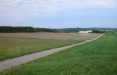 6: Udsigt mod nordøst fra Vinding Ottehøje. Løndal, Velling og Addit Skov rummer også mange fine fortidsminder.