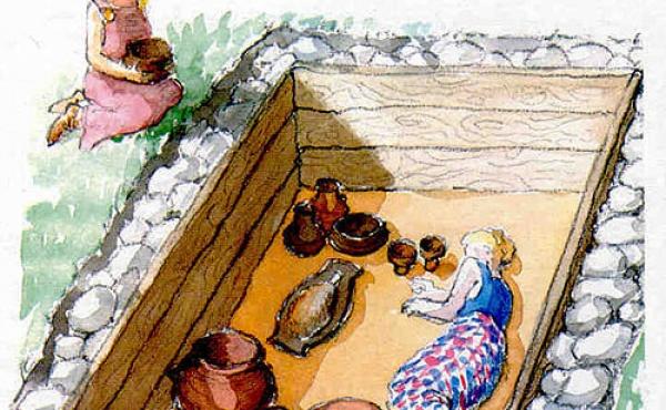 8: Rekonstruktion af den træbyggede kvindegrav på Rostved-gravpladsen. (venligst udlånt fra informationsfolder)