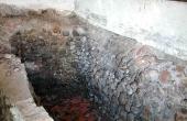Opbevaringsrum for den brændte kalk og råkalk i fyrrummet.